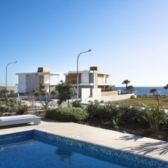 Отель Paradise Cove Luxurious Beach Villas Кипр, Пафос - отзывы, цены и фото номеров - забронировать отель Paradise Cove Luxurious Beach Villas онлайн бассейн фото 12
