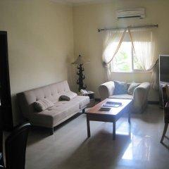 Отель Axari Hotel & Suites Нигерия, Калабар - отзывы, цены и фото номеров - забронировать отель Axari Hotel & Suites онлайн комната для гостей фото 5