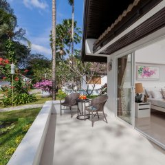 Отель Thavorn Beach Village Resort & Spa Phuket 4* Коттедж разные типы кроватей фото 9