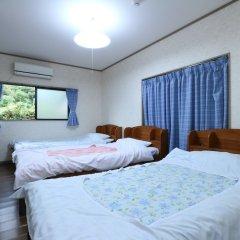 Отель Minshuku Shiratani Якусима комната для гостей фото 2