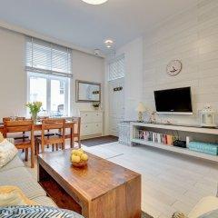 Апартаменты Lion Apartments - Scandi Love III Сопот комната для гостей фото 3