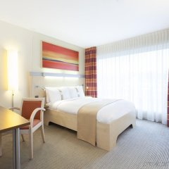 Отель Holiday Inn Express Zurich Airport Швейцария, Рюмланг - 1 отзыв об отеле, цены и фото номеров - забронировать отель Holiday Inn Express Zurich Airport онлайн комната для гостей фото 3