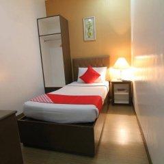 Отель OYO 106 24H City Hotel Филиппины, Макати - отзывы, цены и фото номеров - забронировать отель OYO 106 24H City Hotel онлайн комната для гостей фото 4