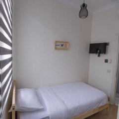 Апартаменты Flats Company- Firuze Apartment Стамбул сейф в номере