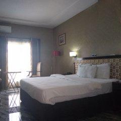 Отель Adig Suites Нигерия, Энугу - отзывы, цены и фото номеров - забронировать отель Adig Suites онлайн комната для гостей фото 2