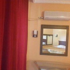 Отель Kleopatra Ikiz Otel сейф в номере