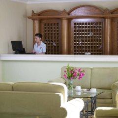 Отель Mitsis Family Village Beach Hotel Греция, Калимнос - отзывы, цены и фото номеров - забронировать отель Mitsis Family Village Beach Hotel онлайн интерьер отеля