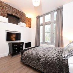 Апартаменты Spacious & Modern 2 Bed Apartment at Knightsbridge London Лондон комната для гостей фото 4