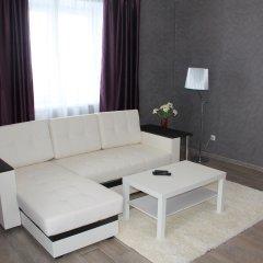 Апарт-Отель Столичный Тюмень комната для гостей фото 2