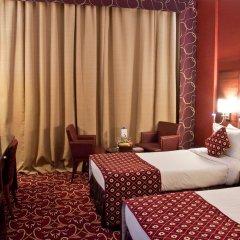 Ramee Rose Hotel комната для гостей