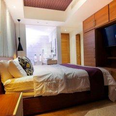 Отель Beach Rock Condo Boutique Доминикана, Пунта Кана - отзывы, цены и фото номеров - забронировать отель Beach Rock Condo Boutique онлайн комната для гостей фото 2