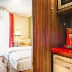Отель Leonardo Hotel & Residenz München Германия, Мюнхен - 11 отзывов об отеле, цены и фото номеров - забронировать отель Leonardo Hotel & Residenz München онлайн удобства в номере фото 2