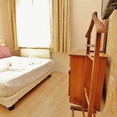 Апартаменты Camelot Apartment комната для гостей фото 4