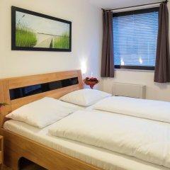 Отель Novum Hotel Kaffeemühle Австрия, Вена - 7 отзывов об отеле, цены и фото номеров - забронировать отель Novum Hotel Kaffeemühle онлайн комната для гостей