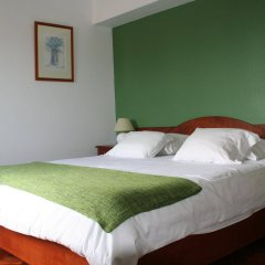 Отель Alcides Португалия, Понта-Делгада - отзывы, цены и фото номеров - забронировать отель Alcides онлайн комната для гостей