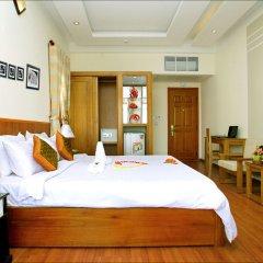 Отель Green Field Villas Хойан сейф в номере