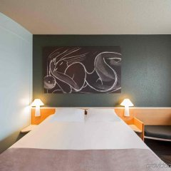 Отель Novotel Suites München Parkstadt Schwabing Германия, Мюнхен - 9 отзывов об отеле, цены и фото номеров - забронировать отель Novotel Suites München Parkstadt Schwabing онлайн комната для гостей фото 3