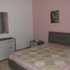 Отель Appartamento La scogliera Сиракуза комната для гостей