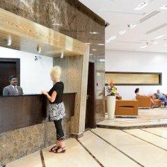 Отель Al Majaz Premiere Hotel Apartment ОАЭ, Шарджа - 1 отзыв об отеле, цены и фото номеров - забронировать отель Al Majaz Premiere Hotel Apartment онлайн интерьер отеля