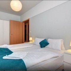 Апартаменты Agape Apartments комната для гостей