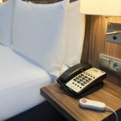 Отель Holiday Inn Express Frankfurt City Hauptbahnhof сейф в номере фото 2