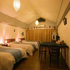 Отель Surfside Bed & Breakfast Центр Окинавы комната для гостей фото 4