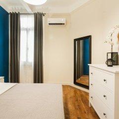 Апартаменты Monastiraki Apartments by Livin Urbban комната для гостей фото 3