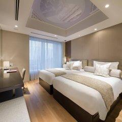 Отель Ascott Marunouchi Tokyo Токио комната для гостей фото 3
