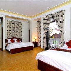 Отель Memories Homestay Хойан сейф в номере