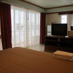 Апартаменты Rouge Service Apartments Паттайя комната для гостей фото 4