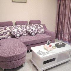 Апартаменты Shenzhen Xin Phoenix Gang Ao 8 Apartment комната для гостей фото 4