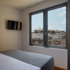 Отель Fos DownTown Suites Афины комната для гостей фото 15
