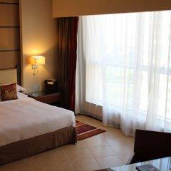 Отель Khalidiya Palace Rayhaan by Rotana комната для гостей фото 8