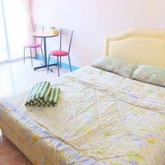 Апартаменты Kimhant Apartment Паттайя комната для гостей фото 2