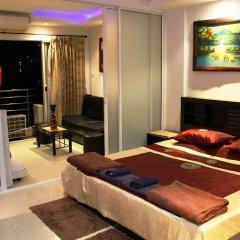 Апартаменты Wongamat Privacy By Good Luck Apartments Паттайя комната для гостей фото 4