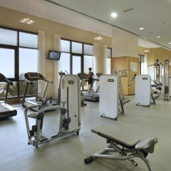 Отель Amwaj Rotana, Jumeirah Beach - Dubai фитнесс-зал фото 2