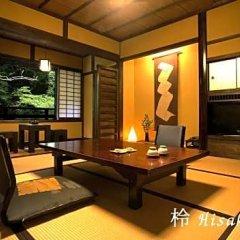 Отель Sanga Ryokan Минамиогуни комната для гостей фото 4
