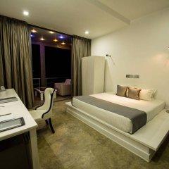 Отель VIlla Thawthisa сейф в номере