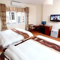 The World Inn Hotel And Travel Ханой комната для гостей фото 3