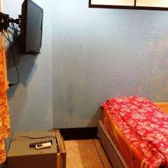 Отель Pandia House сейф в номере