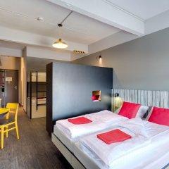 Отель Meininger Brussels City Center Брюссель сейф в номере