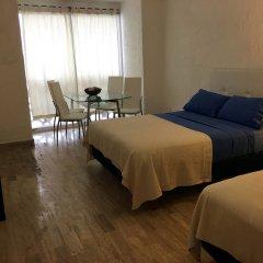 Отель Cancun Plaza Condo комната для гостей