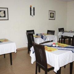 Отель Michelle Suites Нигерия, Калабар - отзывы, цены и фото номеров - забронировать отель Michelle Suites онлайн питание