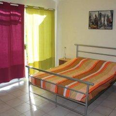 Отель Residence Les Cocotiers Французская Полинезия, Папеэте - отзывы, цены и фото номеров - забронировать отель Residence Les Cocotiers онлайн комната для гостей фото 2