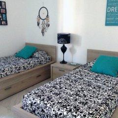 Апартаменты Luxury Seafront Apartment With Pool Каура комната для гостей