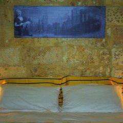 Отель Casa Fortunato Corte Adorni Лечче сейф в номере