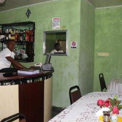 Отель Bv.Standard Executive Suite Нигерия, Калабар - отзывы, цены и фото номеров - забронировать отель Bv.Standard Executive Suite онлайн интерьер отеля