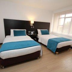 Отель Dann Cali Колумбия, Кали - отзывы, цены и фото номеров - забронировать отель Dann Cali онлайн комната для гостей фото 3