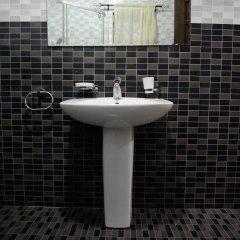 Отель Mount Pleasant Inns & Apartment Гана, Кофоридуа - отзывы, цены и фото номеров - забронировать отель Mount Pleasant Inns & Apartment онлайн ванная фото 2