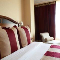 Гостиница Crowne Plaza Minsk комната для гостей